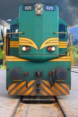 Old diesel locomotive moving on rail tracks
