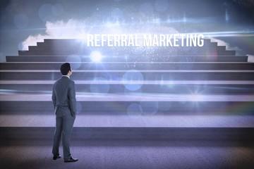 Referral marketing against steps against blue sky