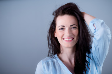 Isolated studio portrait of cheerful young woman