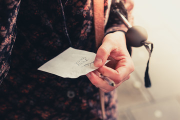Young woman holding a note