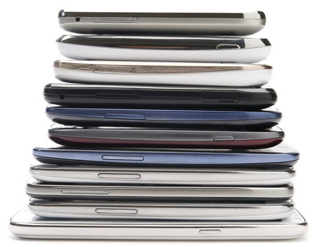 Bunch of old mobile phones isolated on white background