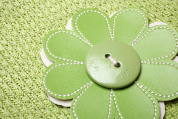 Button sewed on flower shaped fabric