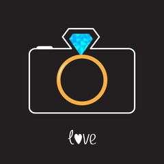 Photo camera and gold wedding ring lens. Diamond flash. Love car