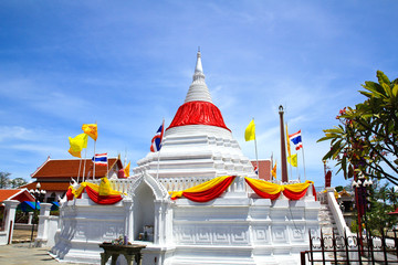 White pagoda against blue sky at Wat Poramaiyikawas Temple in No