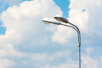 Street Light On Blue Sky With White Clouds