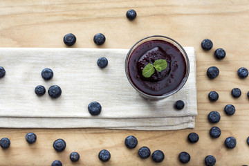 Blueberry smoothie on wooden background