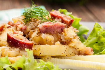 Scalloped potatoes with sausage and bacon