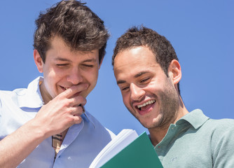 couple of friends laughing about a photo album