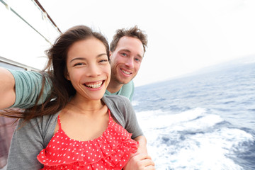 Cruise ship couple taking selfie photo