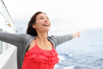 Wall Mural - Cruise ship woman on boat in happy free pose