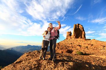 Wall Mural - Couple taking selfie hiking in beautiful nature