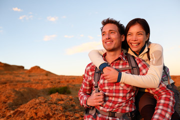 Happy couple active lifestyle hiking outdoors