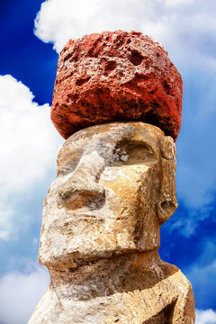 Face of a maoi with a red hat in Easter Island