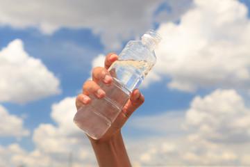 Bottle of water on blue sky