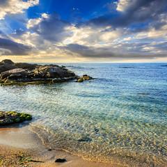 calm sea with waves on  sandy beach