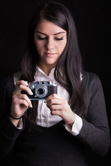 Woman photographer holding vintage film camera