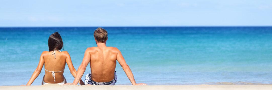 Beach travel banner - romantic couple relaxing