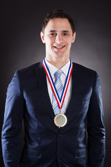 Happy Businessman Wearing Medal