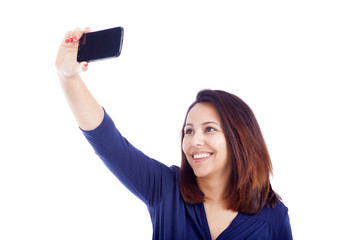 Beautiful woman taking a selfie with smartphone, isolated on whi