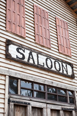 Saloon sign on western wooden building