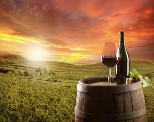 Foto auf Leinwand Weinberg Red wine still life with vineyard on backgorund