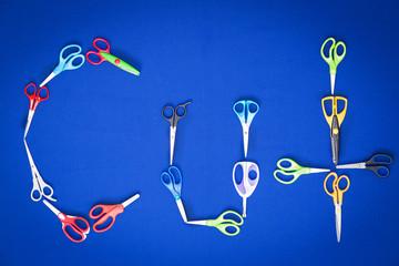 Scissors spelling the word - Cut
