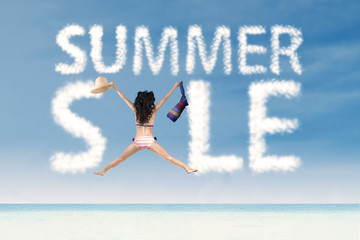 Summer sale clouds with excited woman jumping