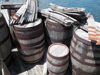 Wooden barrels at a pier