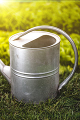 photo of watering can handle at sunny day at garden