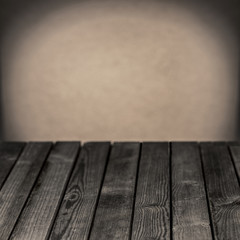 Old wooden rustic table in a grunge room