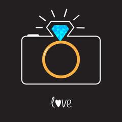 Photo camera and Diamond shining flash. Gold wedding ring lens.