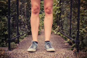 The legs of a young woman outside in nature