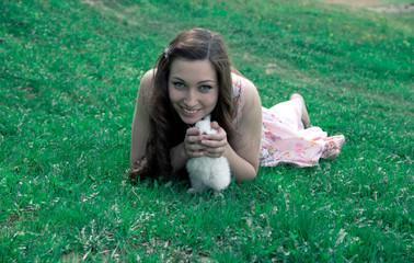 girl holding a white rabbit