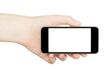 Smartphone in hand, horizontal on white, clipping path