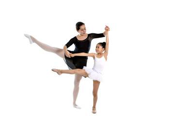 young girl ballerina learning dance lesson with ballet teacher