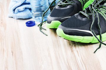 Pair of sport shoes and water bottle