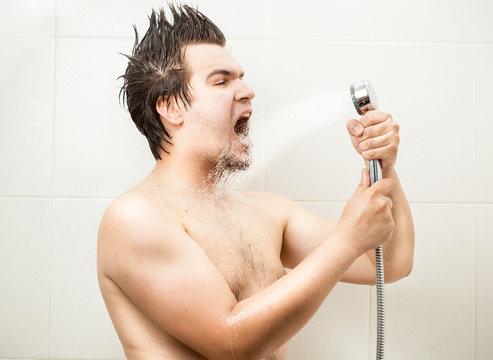 funny man singing at shower