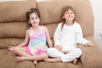 Portrait of two girls in the sofa