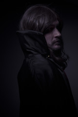 Goth, man with long hair and black coat