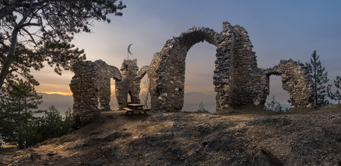 Ruins of a Castle with Mountains in Background