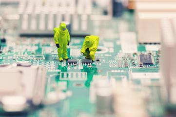 Technicians repairing circuit board