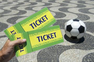 Hand Holding Brazil Tickets w Football Copacabana Rio Brazil