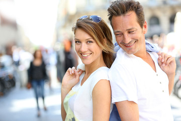 Stylish couple standing in the street