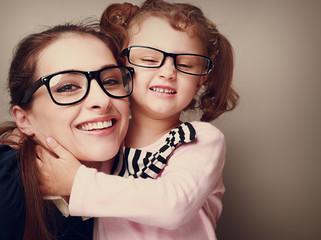Loving happy mother and smiling daughter hugging. Vintage