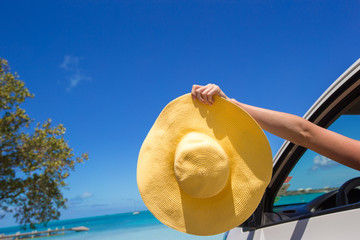 Close up of yellow hat on the car at caribbean island