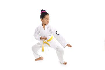 latin little girl in body defensive position like karate kid