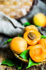 Apricots on rustic wooden background