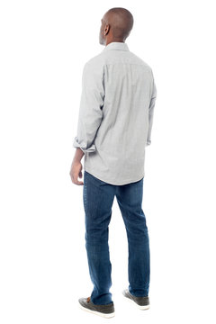 Back view of handsome man looking up