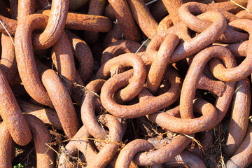 Closeup of large rusty chain links