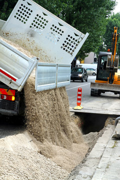 truck tipper during the emptying of the gravel road during the e